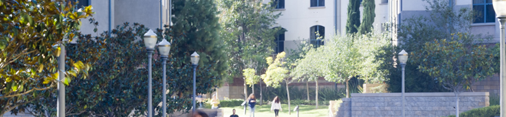 Students walking through a residence hall outdoor courtyard